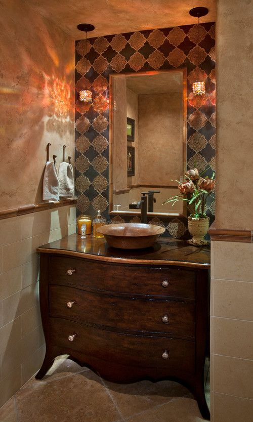 Mediterranean powder room with vessel sink