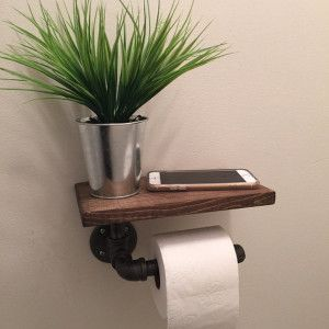 Toilet paper holder made from pipes